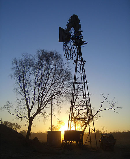 Windmill over sunset